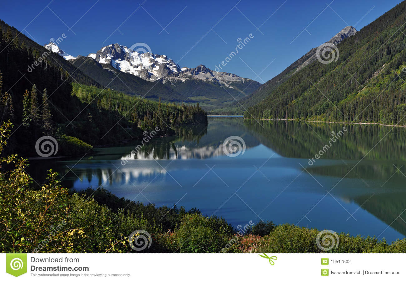 Glaciers Over Mountain Lake Stock Photography.