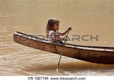 Stock Photo of Lanten girl in her dugout canoe on the Nam Ha River.
