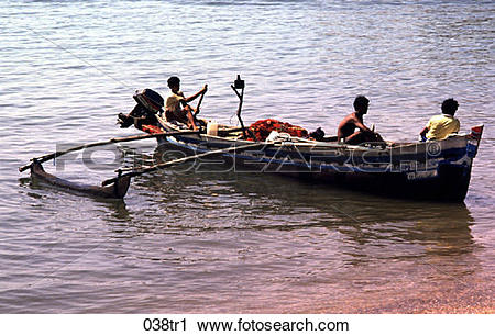 Stock Photography of Fishermen Paddling in a Dugout Boat India.