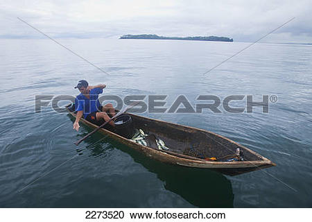 Stock Photography of Man fishing in canoe type dugout boat; panama.