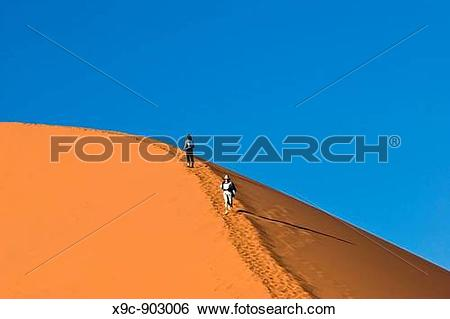 Stock Images of Climbing Dune 45, Namibia x9c.
