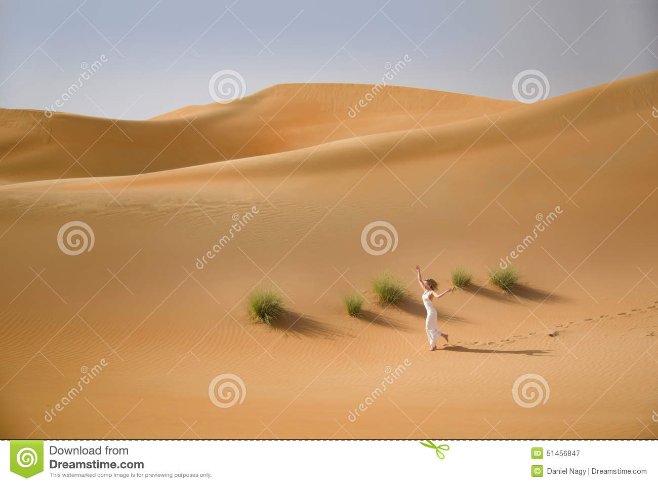 Beautiful Sand Dunes, Grass And A Slim Running Woman In White.