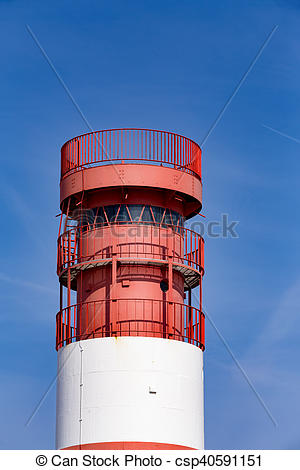Stock Images of lighthouse at heligoland dune island with blue sky.