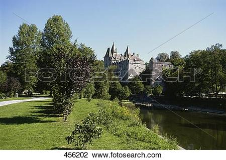 Stock Photo of Canal flowing beside castle, Castle Of Durbuy.