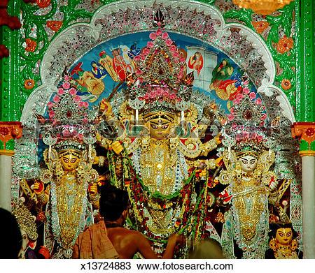 Stock Photo of Poojari doing pooja at goddess Durga temple.