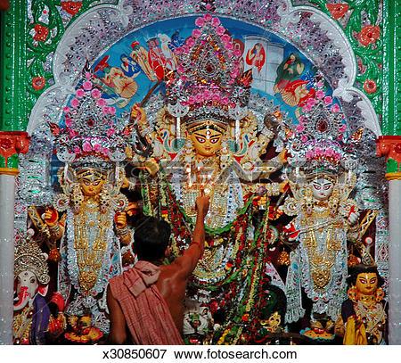 Picture of Poojari doing pooja at goddess Durga temple x30850607.