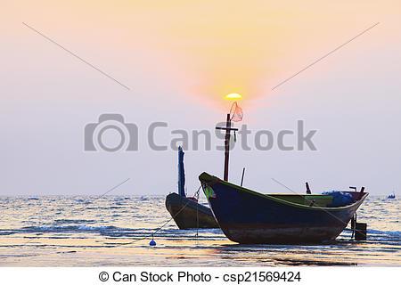 Stock Photo of thai fishery boat on sea beach against beautiful.