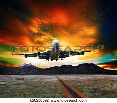 Stock Photo of jet plane flying over runways and beautiful dusky.