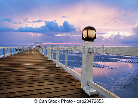 Stock Images of wood piers and sea scene with dusky sky use for.