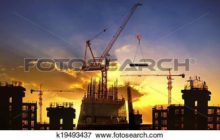 Picture of big crane and building construction against beautiful.
