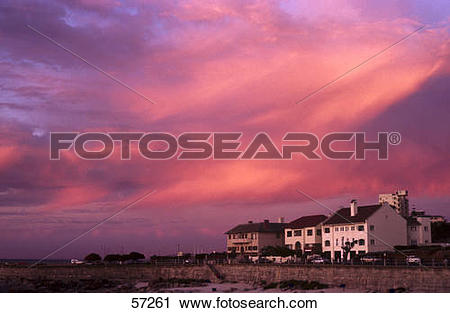 Stock Photography of Buildings in a town under dusky sky, Green.