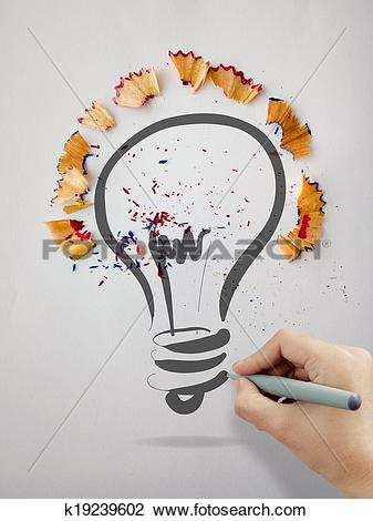 Clip Art of hand drawn light bulb with pencil saw dust on paper.