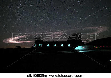 Stock Photo of Dust lights up the rotors of a CH.