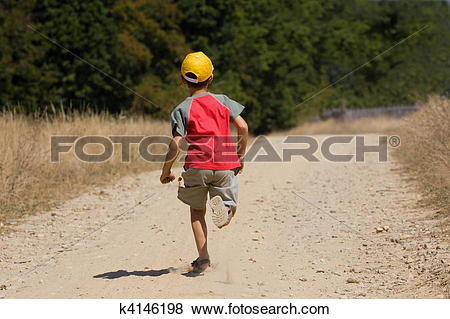 Pictures of Boy running on dusty road k4146198.