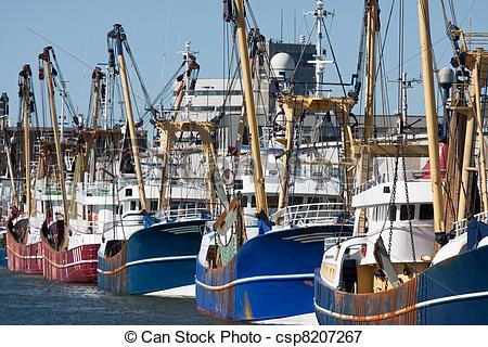 Picture of Dutch harbor with modern fishing cutters.