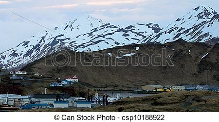 Stock Photo of Early morning summer light over Dutch Harbor Alaska.
