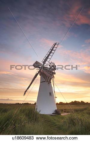 Stock Photo of England, Norfolk, Thurne, Sunrise over Thurne Mill.