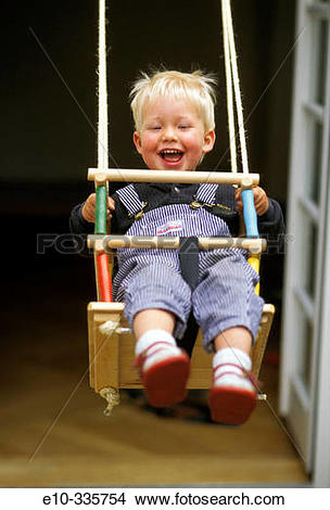 Stock Photo of 2 year old boy in the swing e10.