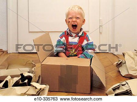Stock Photo of 2 year old boy in a box crying e10.