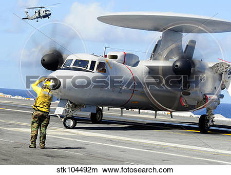 Stock Photo of An Aviation Boatswain's Mate directs a French E.