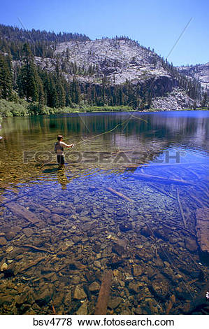 Pictures of Young man fly fishing at Eagle Lake near Lake Tahoe.