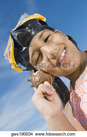 Stock Photo of Portrait of a girl wearing a scuba mask and holding.