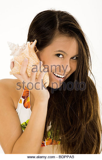 Woman Listening Conch Shell Stock Photos & Woman Listening Conch.