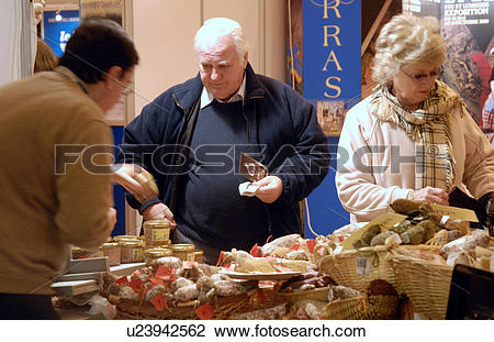 Stock Photo of People at a stand at The France Show at Earls Court.