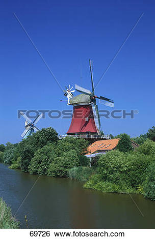 Stock Images of Traditional windmills at waterfront, East Frisia.