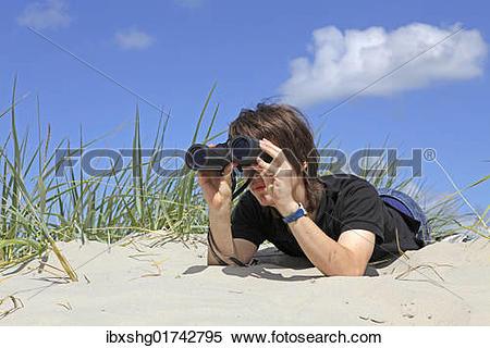 "Stock Image of ""Boy with binoculars, south beach, Borkum island."