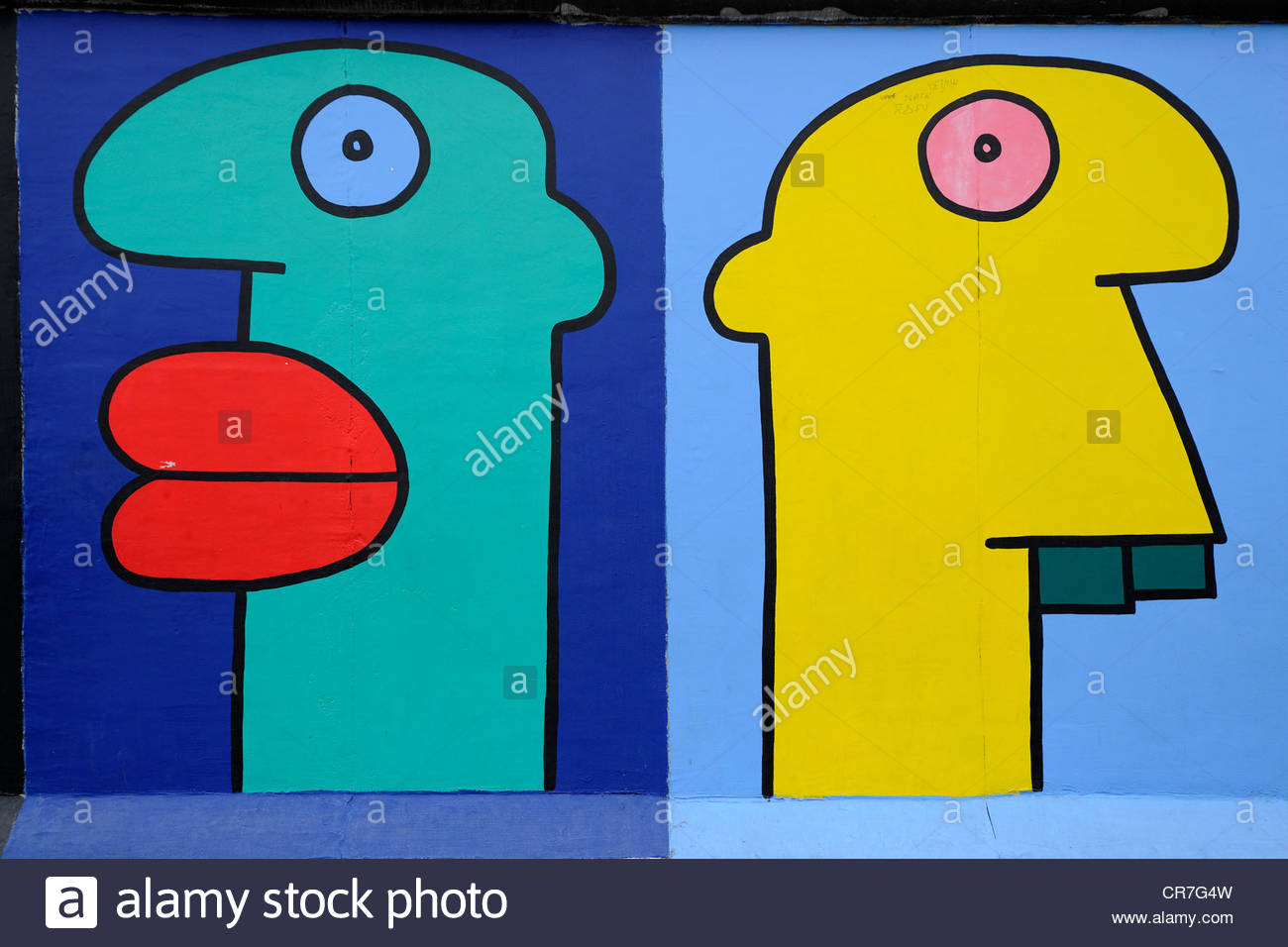 Heads Painted In A Comic Style, Mural By Thierry Noir, Berlin Wall.