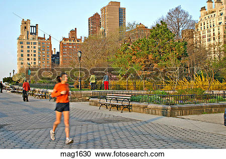 Stock Photography of woman jogging along East River Upper East.