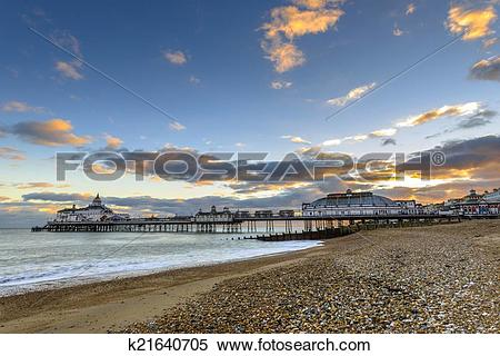 Stock Image of Eastbourne Pier and beach, East Sussex, England, UK.
