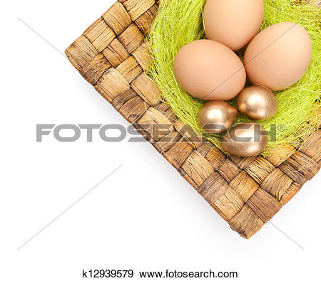Stock Photograph of Easter eggs are on braided plate k12939579.
