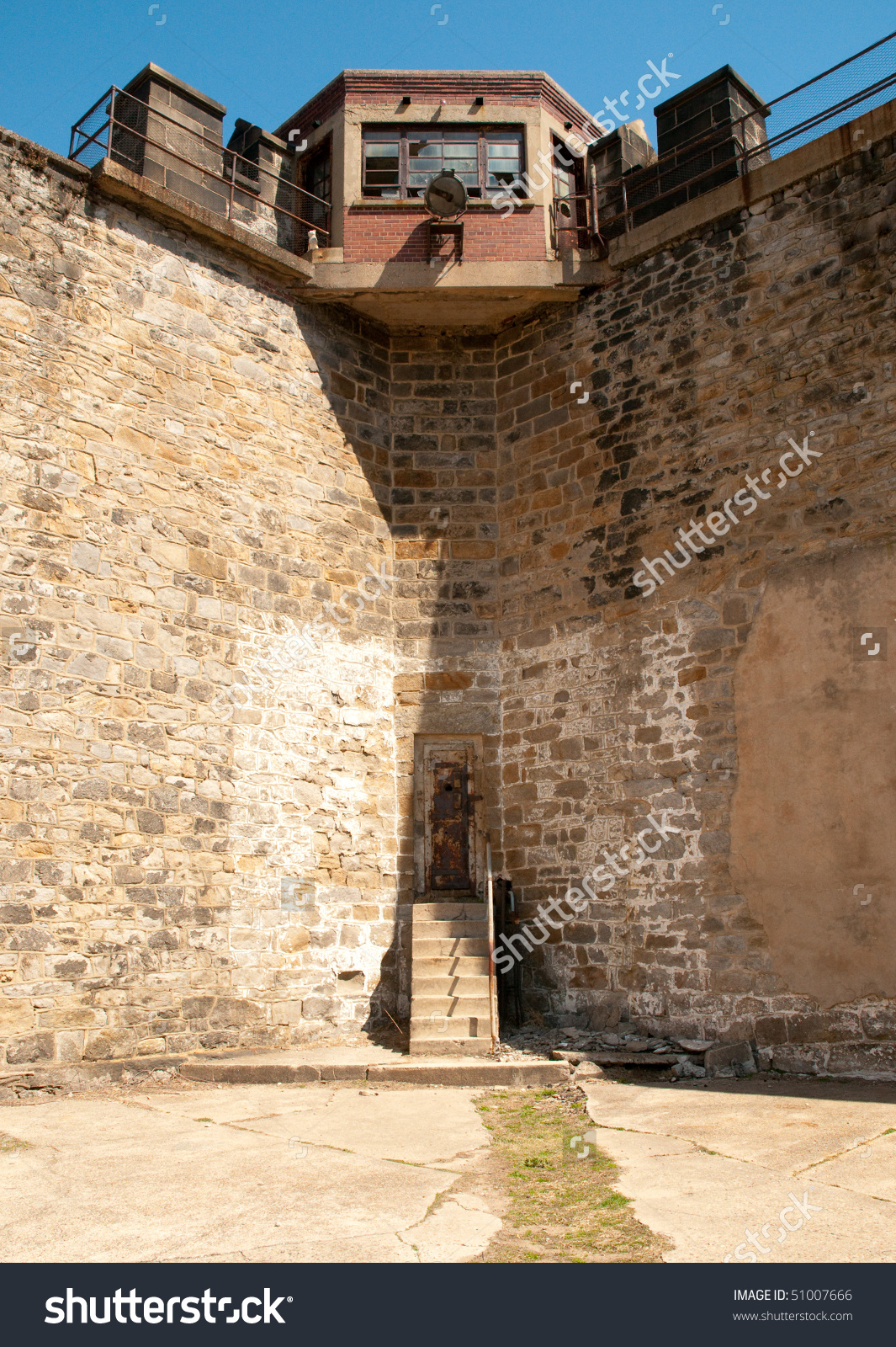 Eastern State Penitentiary Walls And Guard Tower Stock Photo.
