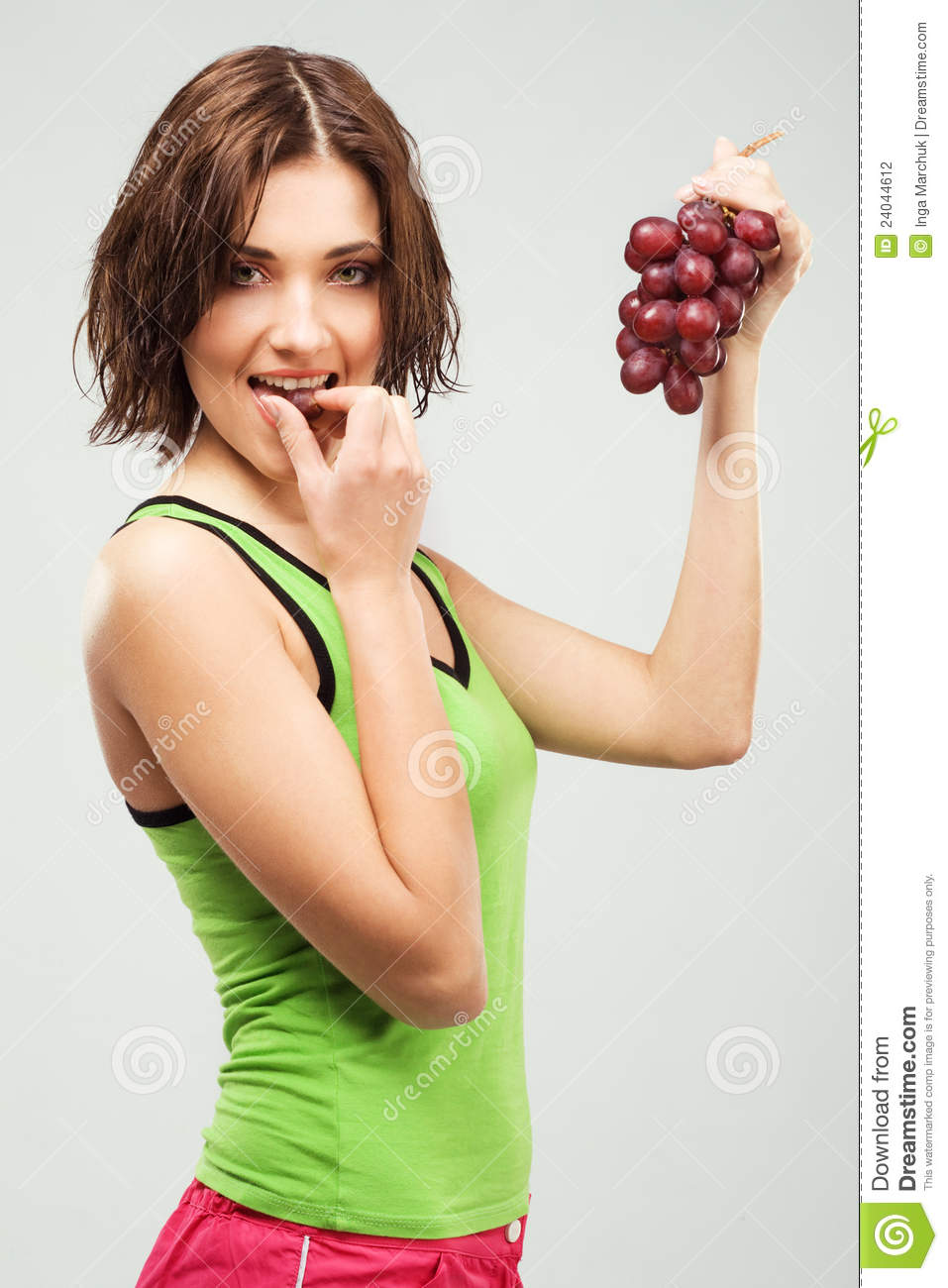 Beautiful Sporty Woman Eating Grapes Stock Photography.