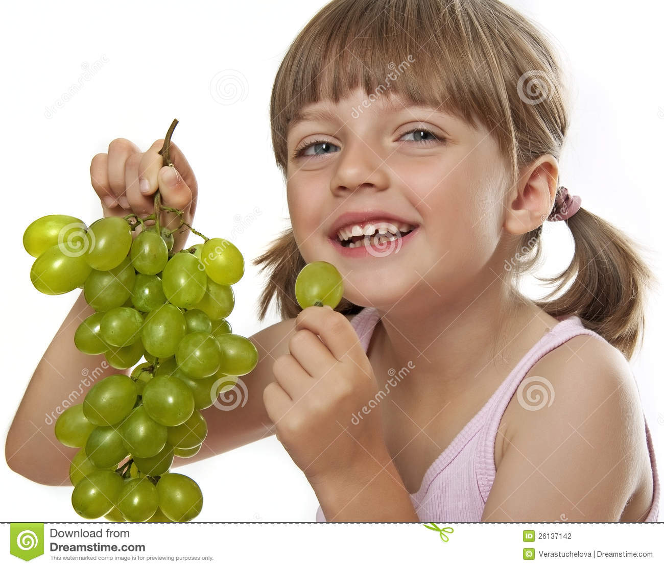 Girl Eating Grapes Stock Photo.