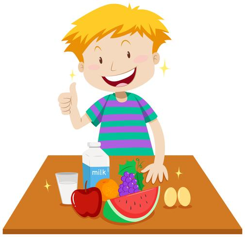 Little boy and healthy food on table.