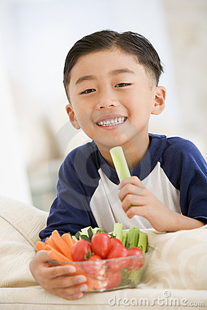 Boy Eating Vegetables Royalty Free Stock Images.