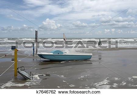 Stock Photo of green boat at ebb tide k7646762.