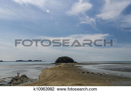Stock Photo of sand road way to island on ebb tide k10963982.