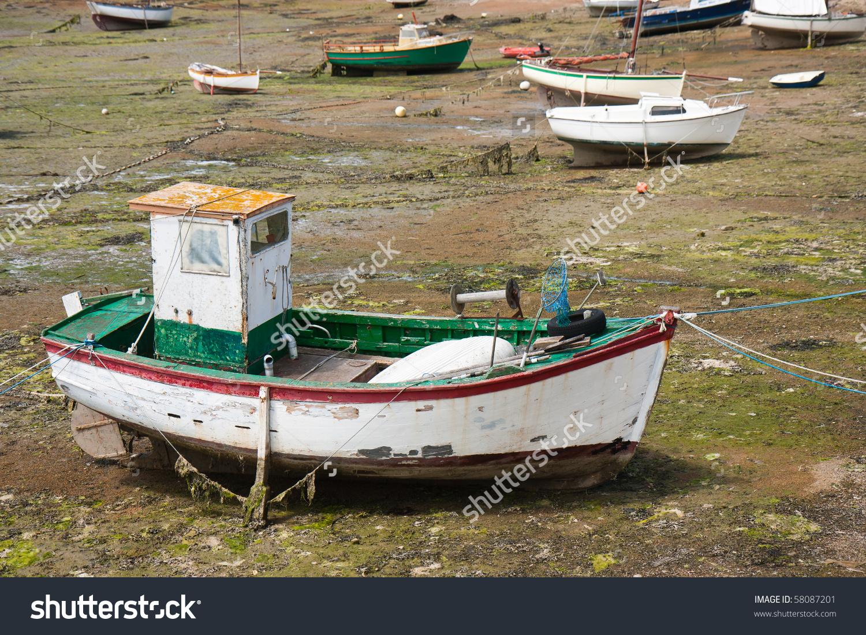 Fishing Boat At Ebb Tide In Bretagne, France Stock Photo 58087201.