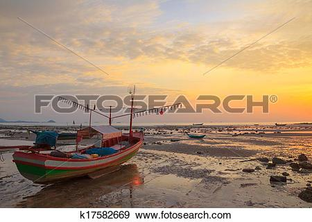Stock Photograph of Small wooden boat with light bulbs for night.