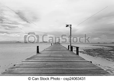Stock Photos of Bridge over the sea during ebb tide in black and.