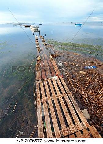Picture of Pallet pier and small fishing boats at Alfacs Bay. Ebro.