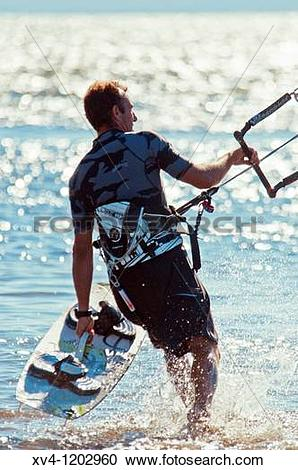 Stock Photography of Kiteboarding in Ebro Delta Nature Park.