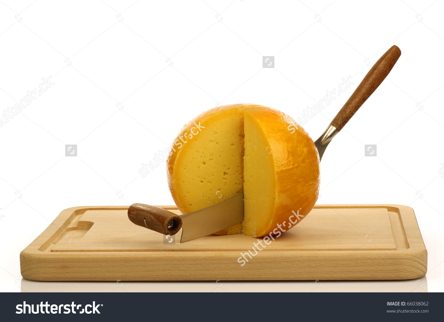 Cut Pieces Of Dutch Edam Cheese With A Cheese Cutter On A Cutting.