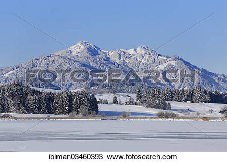 """Stock Photo of """"Frozen Hopfensee Lake with Mount Edelsberg and."""