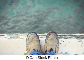 Stock Images of Feet Standing on Cement Edge Near The Sea.