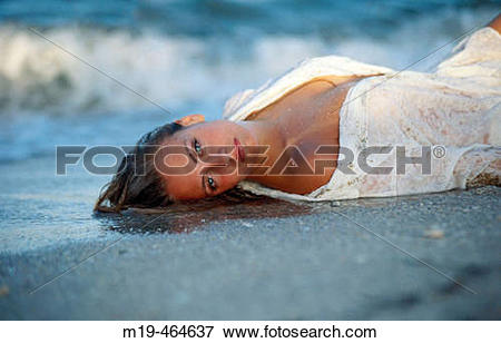 Picture of beach girl lying on the waters edge m19.